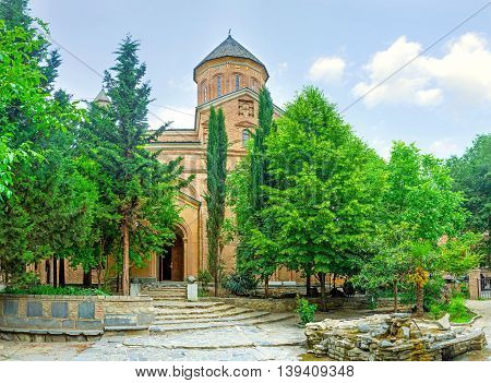 The Norashen Holy Mother of God Church located in Kote Abkhazi street adjacent to Jvris Mama Georgian Church and surrounded by greenery Tbilisi Georgia.