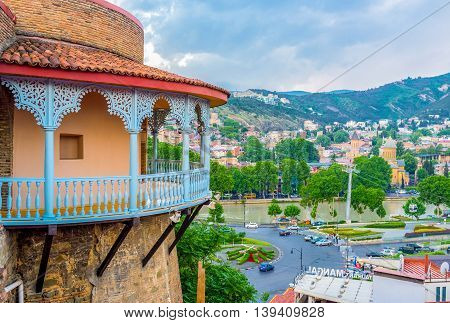 TBILISI GEORGIA - MAY 28 2016: The old town cityscape with the Kura embankment river Sionni Cathedral and the carved wooden balcony of the Queen's Darejan Sachino Palace on May 28 in Tbilisi.
