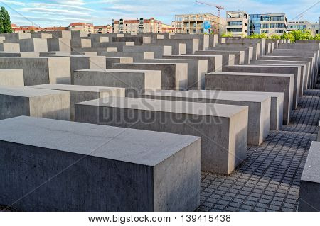 Berlin, Germany - may 31, 2015: Holocaust Memorial (Monument to the Murdered Jews in Europe. Occupying about 19,000 square meters of space near the Brandenburg Gate, the Berlin Holocaust Memorial is made up of 2,711 concrete slabs without markings.