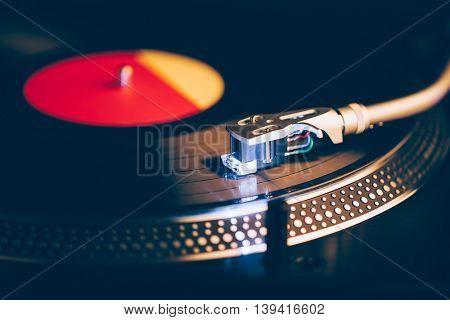professional dj turntable with illumination, dark background