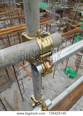 SELANGOR, MALAYSIA -JULY 10, 2016: Scaffolding connector detail at the construction site. The connector bind or tie scaffolding or safety pipe together.