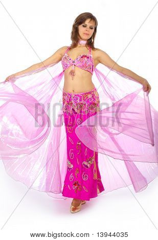 Attractive girl dances east dance isolated on a white background