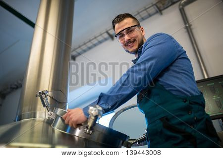 Portrait of happy maintenance worker working at brewery