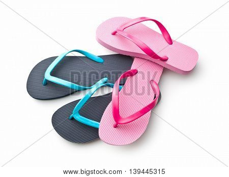 Pink and blue flip flops isolated on white background.