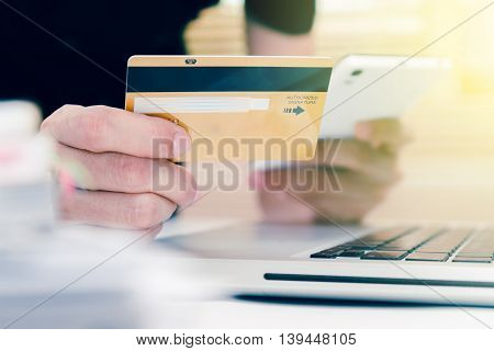 The online shopping card and holding credit card with hand for payment online shopping, this lifestyle new generation of people on the world for decorate/design business content or finance content.