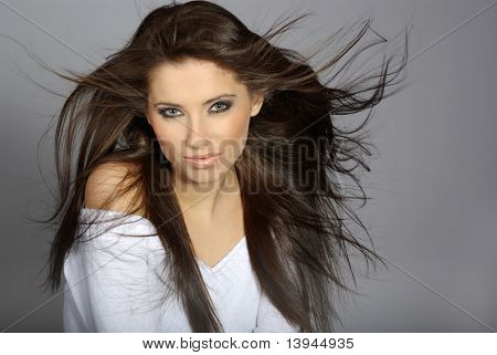 Glamour Portrait of sexy woman on grey background