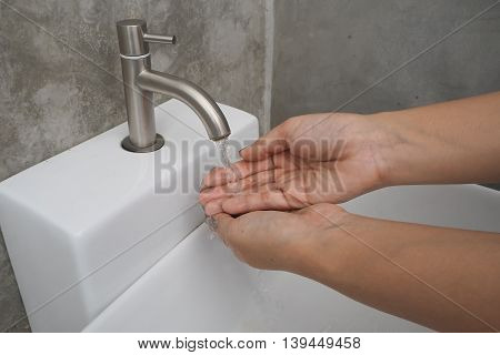 turn on the tap for rinsing hands cleaning concept background.