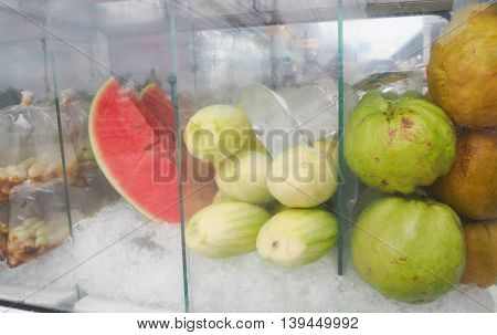 Frozen fruit in glass box lifestyle street food of Asian.