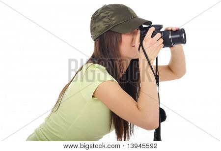 Young girl holding a photo camera. Isolated over white background