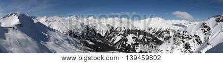 Bad Hofgastein ski resort in Austria. Snow in Alps - Hohe Tauern range in winter. poster