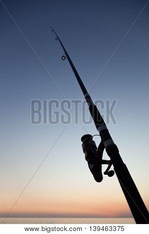Fishing Rod On Sea Beach