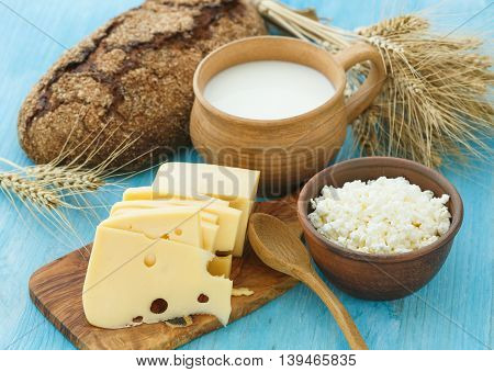 Cottage cheese milk bread and cheese on a wooden background - healthy breakfast concept