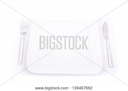 A blank plate with fork and knife.