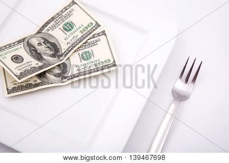 Price of Food and eating wealth. Digital photo.
