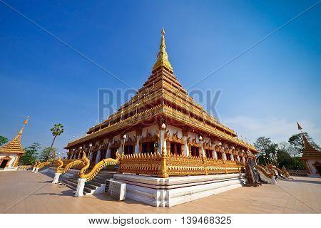 Thailand Bhudda temple golden Stupa Khonkaen landmarkTemple against blue sky in Khon Kaen Thailand; Wat Nong Waeng (Temple)