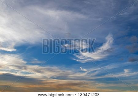 Natural blue sky with Cirrus Clouds formation and yellow shade of sunset