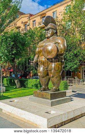 YEREVAN ARMENIA - MAY 29 2016: The monumental sculpture of Roman Warrior by F Botero in sculpture garden in Tamanyan street on May 29 in Yerevan.