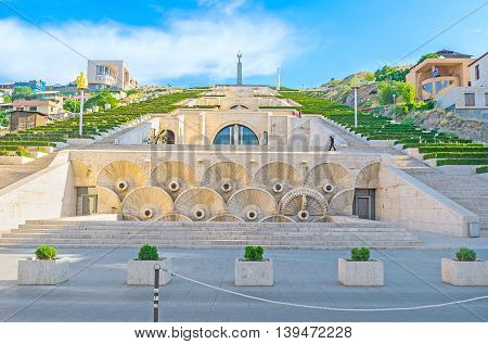 YEREVAN ARMENIA - MAY 29 2016: The first level of the monumental stairway of Cascade with the stone fountains and carved reliefs on May 29 in Yerevan.