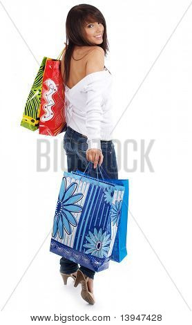 young attractive woman smiling on surprise in the colorful shopping bag