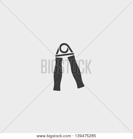 Icon of hand grip exerciser or trainer in a flat design in black color. Vector illustration eps10