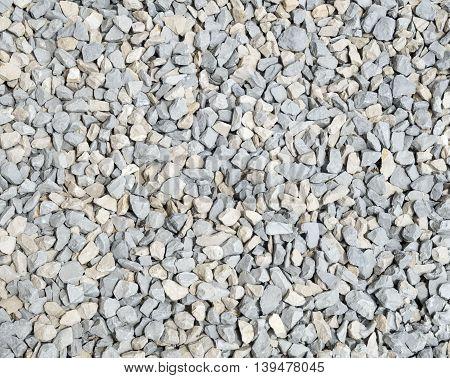 Gray and ecru rubble closeup in sunny day