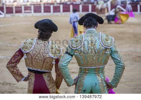 Ubeda SPAIN - september 29 2010: Spanish Bullfighters looking bullfighting the Bullfighter on the left dressed in suit of lights of colors red and gold and the right color pistachio and gold in Ubeda Jaen provincia Andalusia Spain