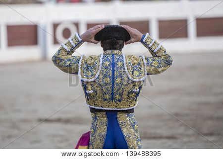 Linares SPAIN - August 28 2014: Spanish bullfighter With his hands on his head wearing his montera in bullring of Linares Spain