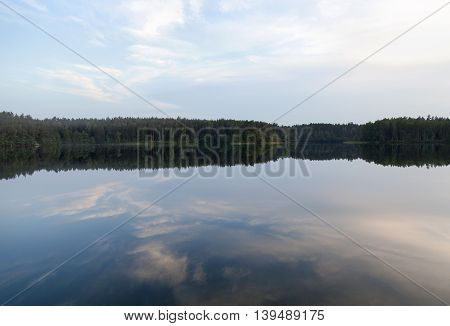 Calm waters of Baltis (White) Lake after the sunset (Lithuania).