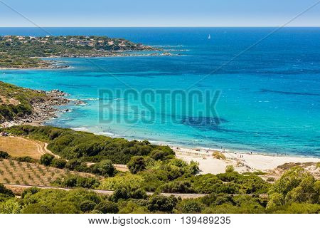 Holidaymakers And Turquoise Mediterranean At Bodri Beach In Corsica