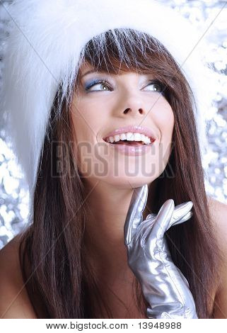 Portrait of beautiful winter woman over silver background