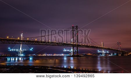 The old and new Forth Road bridges from Queensferry at night