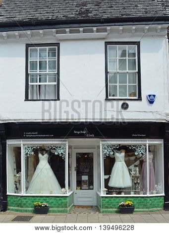 St Ives, Cambridgeshire, England - July 20, 2016: Bridal Shop Store Front with dresses on show.