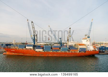 March 18 2016: Large orange cargo ship Glucksburg Docked at the por of Miami Florida USA