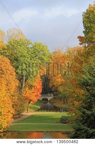 picturesque autumn scenery of park in Warsaw, Poland