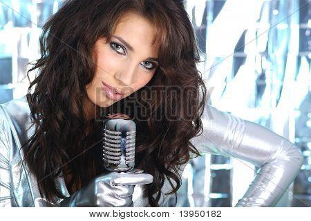 Rock star. Sexy Girl singing in retro mic