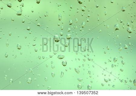 abstruct drops of rain on a window glass