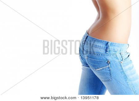 Sexy, fit woman in jeans, with naked stomach