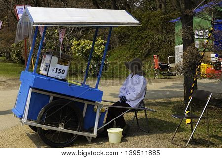 Hirosaki Park Aomori Japan April 15 2016 A merchant with a cart in Hirosaki Park waits to sell food to park visitors. Editorial Use Only.