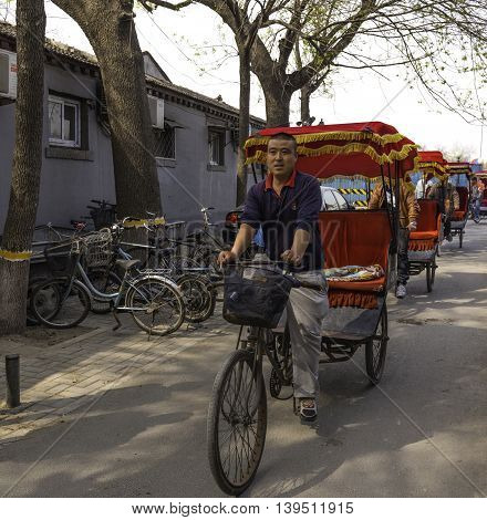 Beijing China April 3 2016 Pedicab drivers lined up waiting for fares in Beijing
