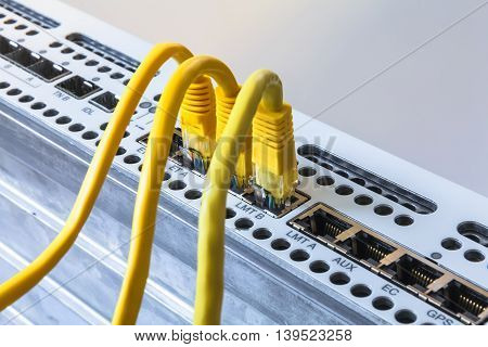 Radio base station and yellow patch cords. Internet. Communication. Network