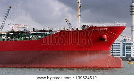 Red Oil Tanker. Oil Tanker Docked at Port of Rotterdam. Petroleum shipping pier.