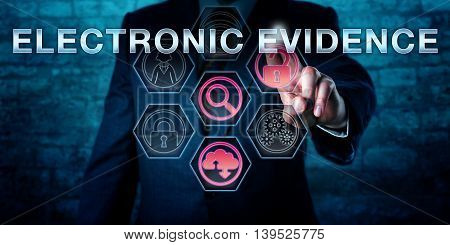 Male forensic examiner is pushing ELECTRONIC EVIDENCE on an interactive touch screen. Information technology concept. Business metaphor for evidence law computer law and digital forensics.