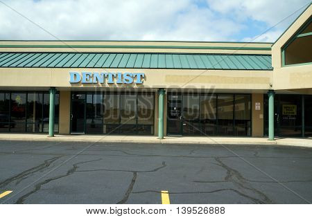 SHOREWOOD, ILLINOIS / UNITED STATES - AUGUST 30, 2015: One may receive dental treatment at Brookforest Dental Care, in a Shorewood strip mall.