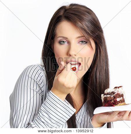 businesswoman wearing white shirt eating the cake.