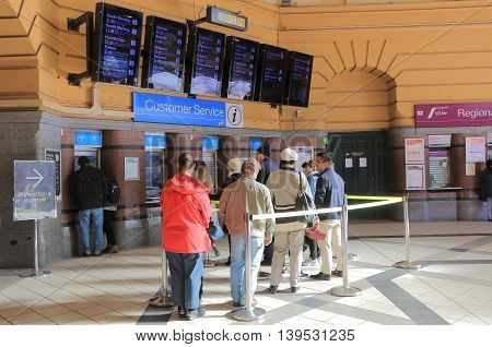MELBOURNE AUSTRALIA - JULY 16, 2016: Unidentified people queue at Flinders Street station. Flinders Street station building was completed in 1909 and is a cultural icon to Melbourne