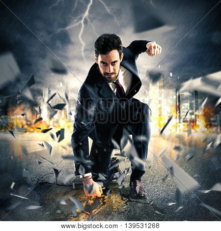 Businessman breaking the asphalt with a punch
