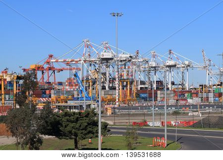 MELBOURNE AUSTRALIA - JULY 17,2016: Cargo ships load and unload containers in Port of Melbourne.