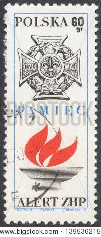 MOSCOW RUSSIA - CIRCA JANUARY 2016: a post stamp printed in POLAND shows the symbol of Polish Scouting organization the series