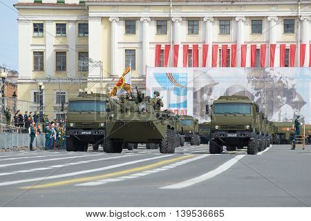SAINT PETERSBURG, RUSSIA - MAY 05, 2015: A column of military vehicles overlooks the Palace square. Rehearsal of parade in honor of Victory Day