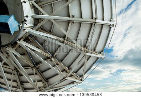 Close up satellite dish with blue sky background